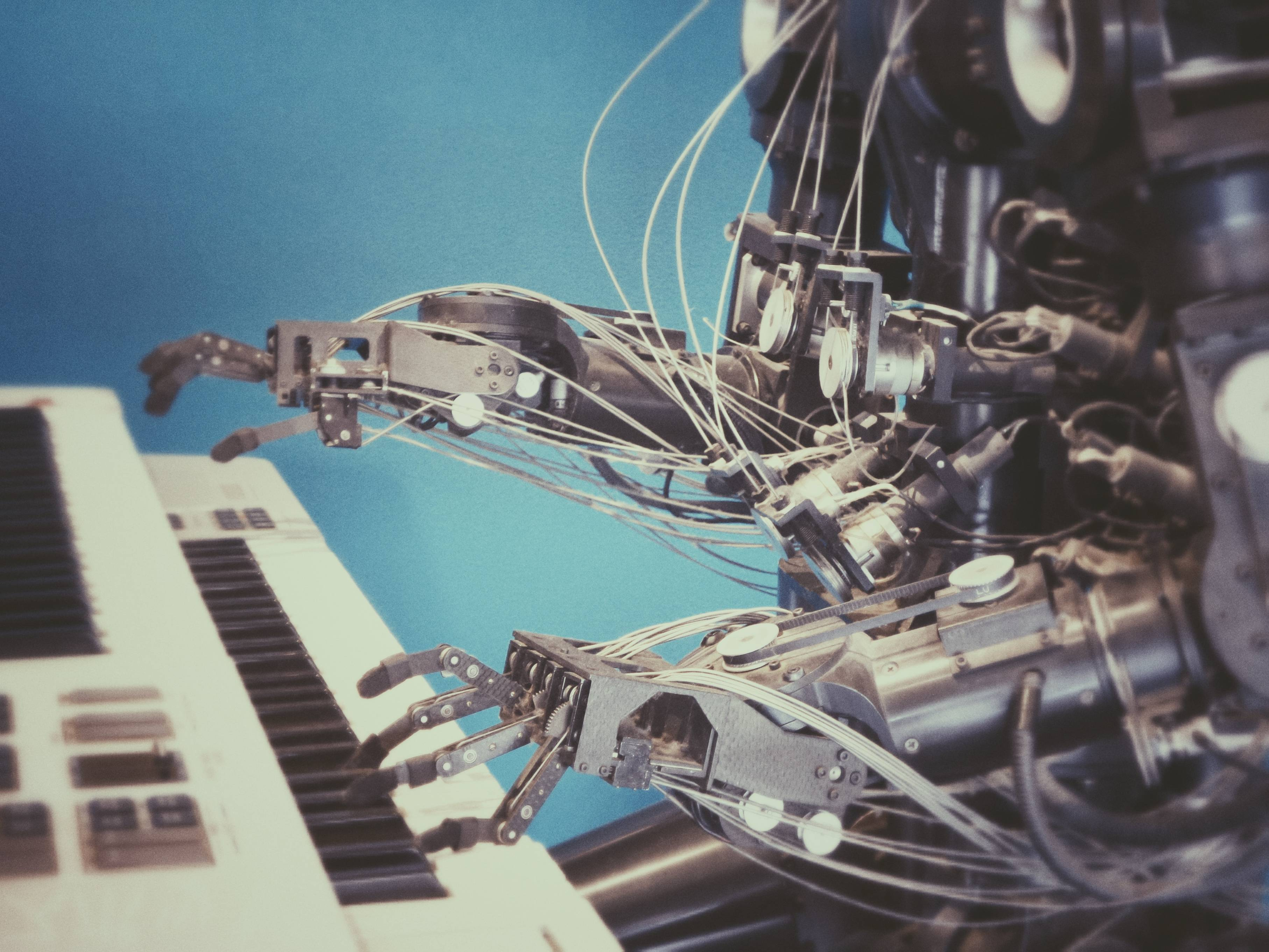 An image of a robot playing a piano.