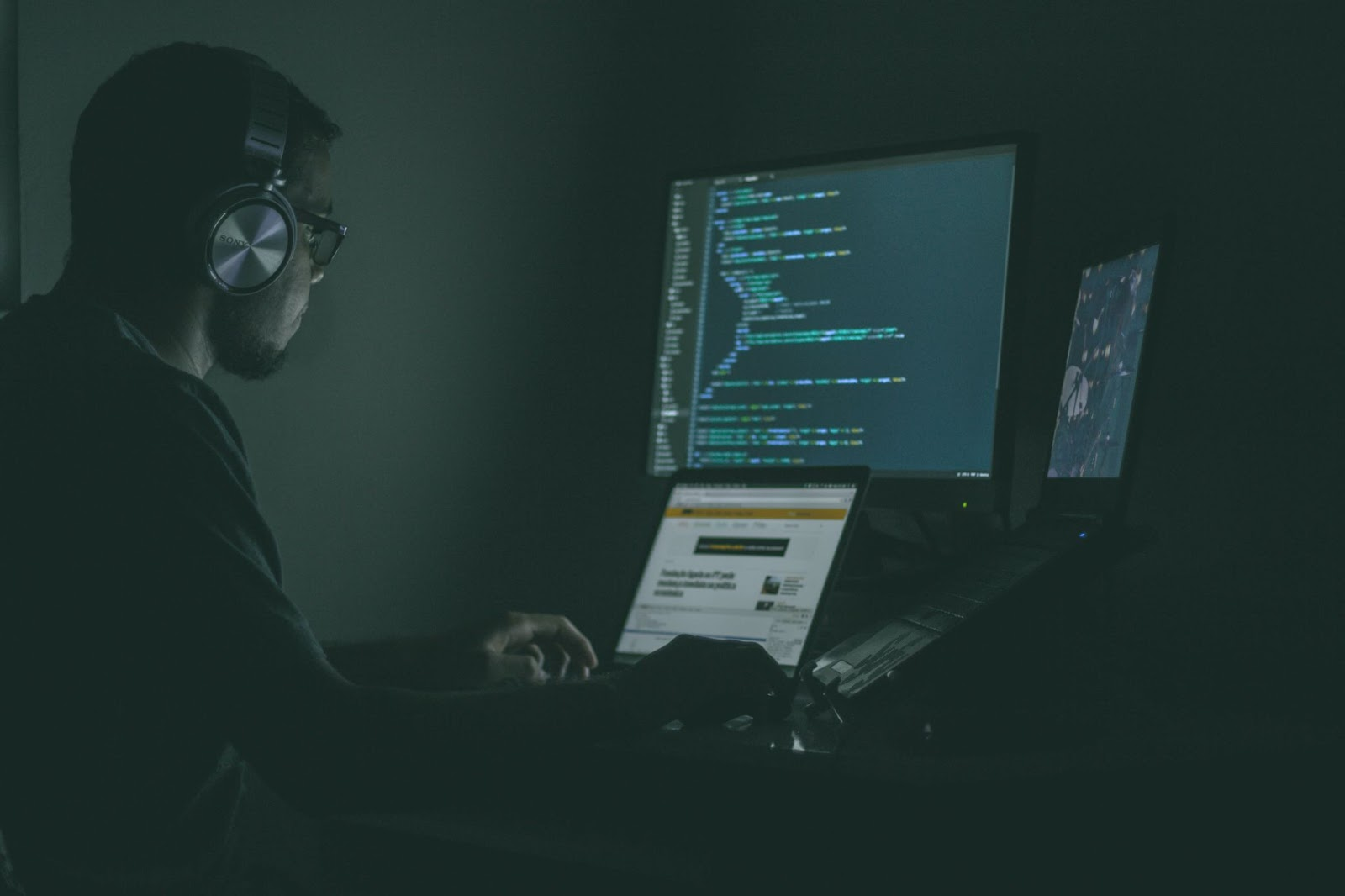 An AI engineer working on an AI project in his workstation.