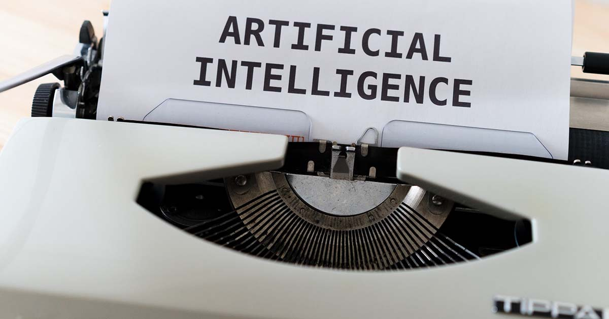 An image of typewriter showing the word Artificial intelligence.